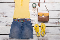 Yellow top and jeans skirt. Stock Photos