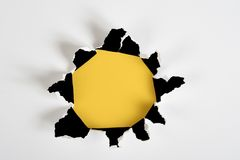 Yellow torn out hole Royalty Free Stock Images