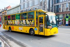 Yellow tourist bus on the road Royalty Free Stock Image