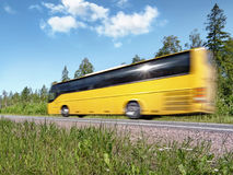 Yellow tourist bus on rural highway, motion blur. Yellow tourist bus speeding on country highway, blured in motion, with reflecting sun Stock Photo
