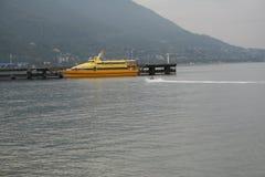 Yellow tourist catamaran. Royalty Free Stock Image