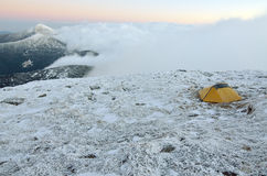 Yellow touristic tent on a snowy peak Stock Photography