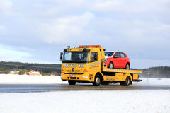 Yellow Tow Truck Carries Breakdown Car Stock Photo