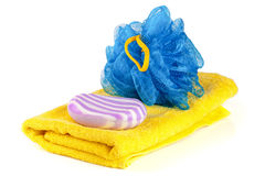 Yellow towel with blue bath sponge and soap isolated on white background Royalty Free Stock Photography