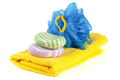 Yellow towel with blue bath sponge and soap isolated on white background Royalty Free Stock Photos