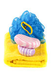 Yellow towel with blue bath sponge and soap isolated on white background Royalty Free Stock Images