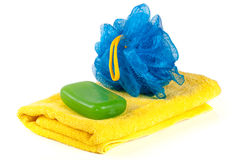Yellow towel with blue bath sponge and soap isolated on white background Royalty Free Stock Image