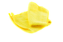 Yellow towel folded in the shape of a square. On a white background Royalty Free Stock Photo