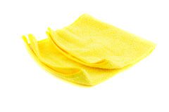 Yellow towel folded in the shape of a square. On a white background Royalty Free Stock Image