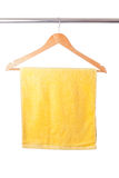 Yellow towel on hanger. Isolated on white background Royalty Free Stock Images