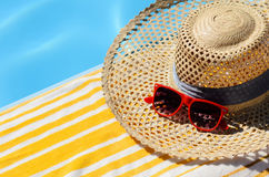 Yellow towel and  red glasses Royalty Free Stock Image