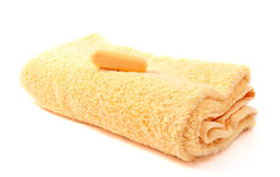 Yellow towel and soap Stock Photos
