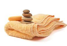 Yellow towel and soap Royalty Free Stock Photography