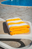 Yellow towels on sun lounger near the swimming pool Royalty Free Stock Photos