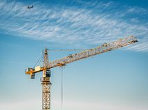 The yellow tower crane on a background of clouds royalty free stock image
