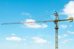 Yellow tower-crane of a construction site Royalty Free Stock Photography