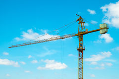 Yellow tower-crane of a construction site Royalty Free Stock Photos