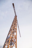 Yellow tower crane Stock Image