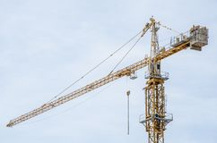 Yellow tower crane Stock Images