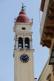 Yellow the town hall with clock in Kerkyra. Corfu. Greece. Royalty Free Stock Photography