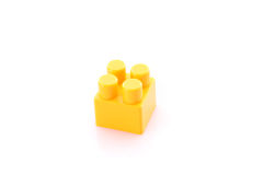 Yellow toy building brick isolated Stock Photos