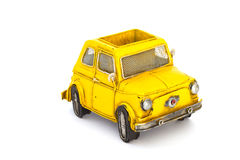 Yellow toy car. Isolated yellow vintage toy car Stock Photography