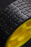 Yellow toy car wheel Royalty Free Stock Photo