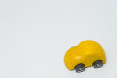 Yellow toy car with white background and selective focus Stock Photography