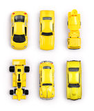 Yellow toy cars. On white background Stock Images