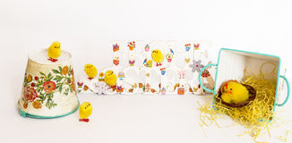 Yellow toy chicks around painted congratulation Happy Easter in German on the white background Royalty Free Stock Images