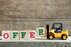 Yellow toy forklift hold letter block R to complete word offer royalty free stock photos