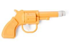 Yellow toy gun. On white background Royalty Free Stock Photos