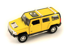 Yellow toy jeep. Isolated object on white background. Stock Photos