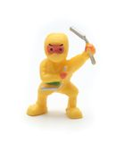 Yellow toy ninja. Isolated yellow Plastic Ninja on White Background Royalty Free Stock Photos