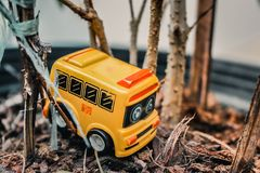 The Yellow toy school bus. Is in the jungle in Thailand garden Royalty Free Stock Photo