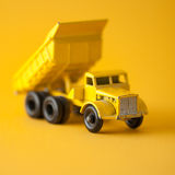 Yellow toy in studio. Yellow truck toy in studio with colorful background Stock Photo