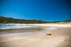 Yellow toy truck on a beach royalty free stock photos