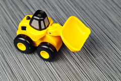 Yellow toy truck Stock Images