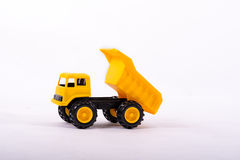 Yellow toy truck isolated on white Royalty Free Stock Photos