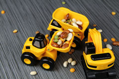Yellow toy trucks Royalty Free Stock Images