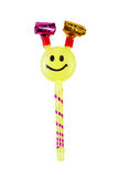 Yellow toy whistle with a smiley face isolated Stock Image