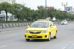 Yellow  Toyota Corolla Altis taxi Royalty Free Stock Photos