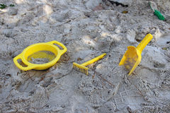 Yellow toys in the sandbox Royalty Free Stock Images