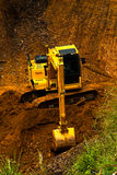 Yellow track-type loader excavator machine doing earthmoving wor Royalty Free Stock Photo