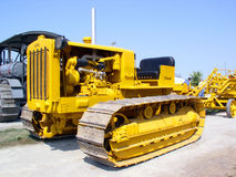 Yellow Tractor. Tracked type tractor stock photo