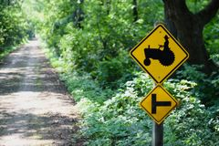 Yellow tractor crossing sign stock photo