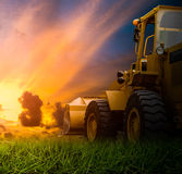 Yellow tractor in a field Royalty Free Stock Photos