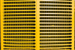 Yellow tractor grill. Radiator grill from vintage farm tractor Royalty Free Stock Photos