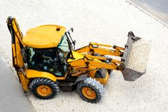 Yellow tractor leads road works royalty free stock image