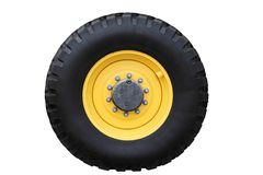Yellow tractor wheel. Yellow tractor wheel isolated on a white background Stock Photography